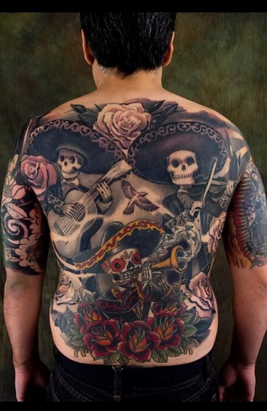 Amazing designed and colored massive Mexican musician skeletons tattoo on whole back