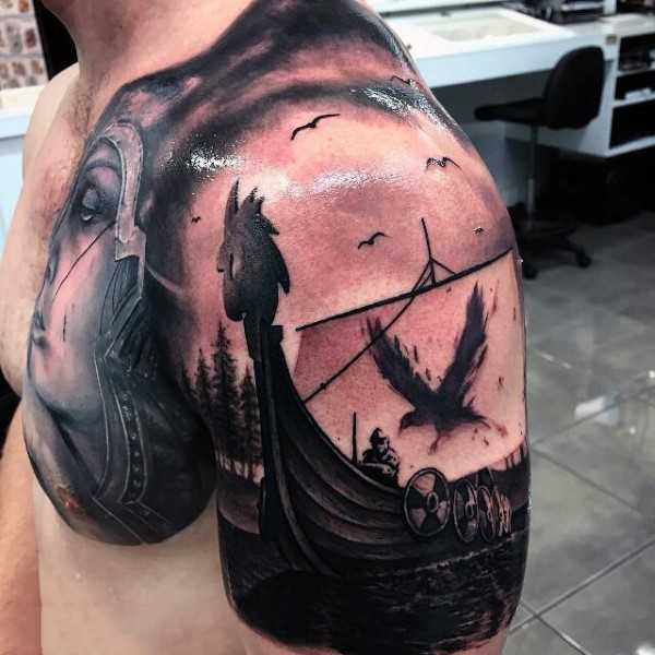 Amazing designed and detailed viking ship with crow on sail tattoo on chest and shoulder