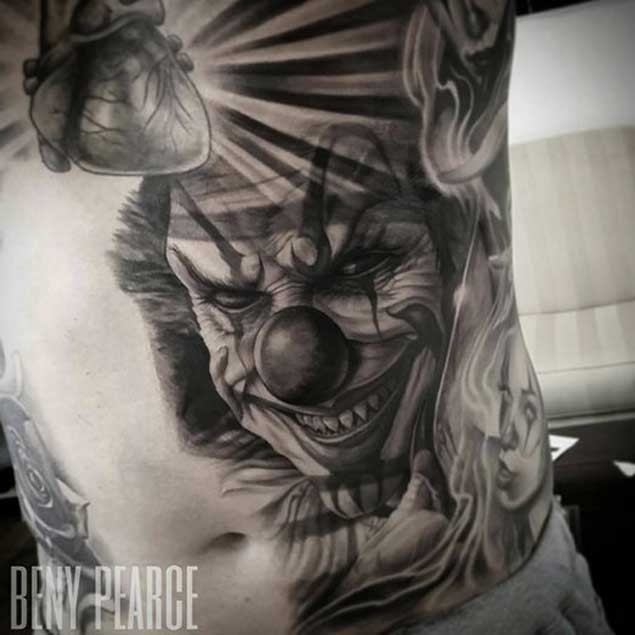 Amazing detailed and colored creepy clown tattoo on side
