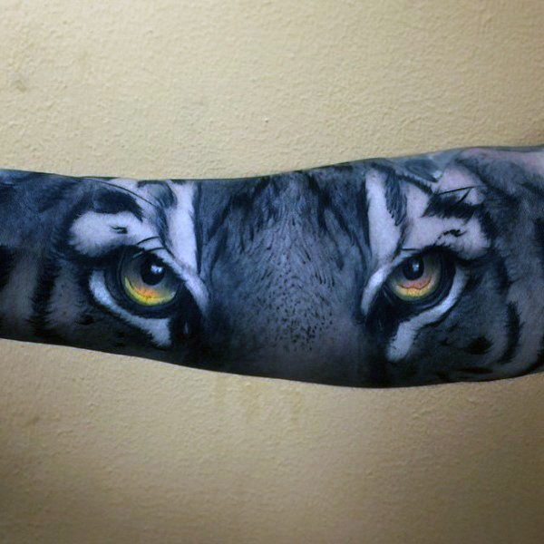 Amazing detailed colorful creepy tiger look tattoo on sleeve