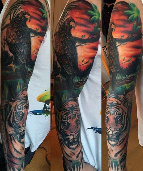 Amazing detailed colorful wild life with tiger and eagle tattoo on sleeve
