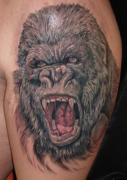 Amazing gray-ink gorilla tattoo on upper arm