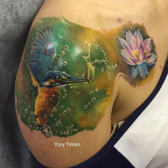 Amazing hummingbird with flower tattoo by Timko