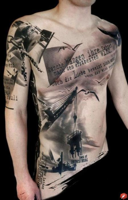 Amazing industrial themed massive black and white tattoo with lettering on chest and shoulder