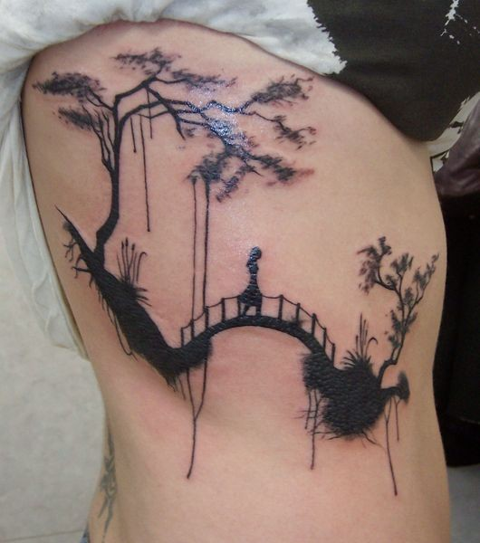 Amazing landscape with suspension bridge tattoo on ribs