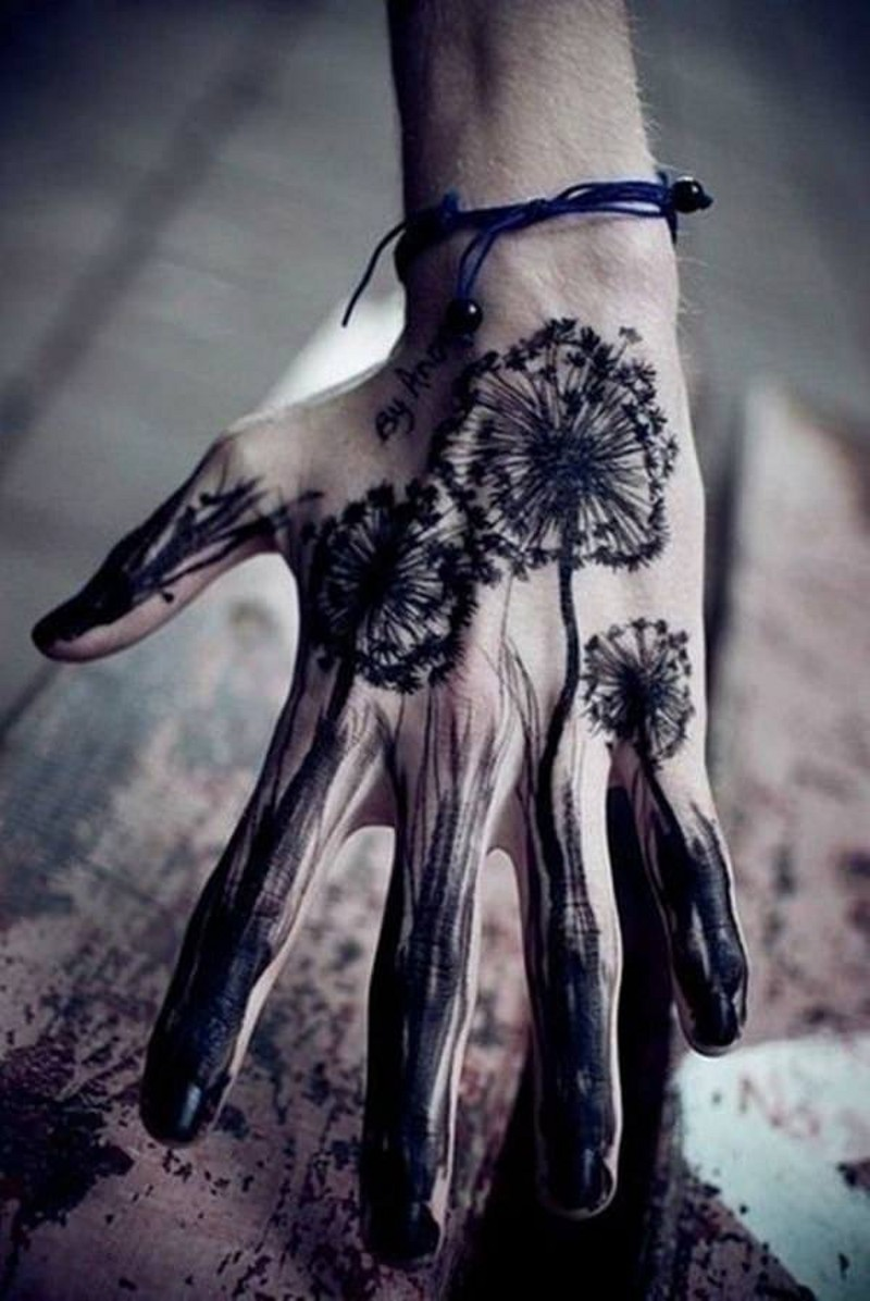 Amazing looking black ink homemade wild flowers tattoo on hand