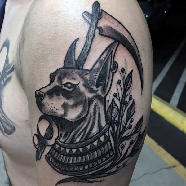Amazing looking black ink shoulder tattoo of saint dog with plants