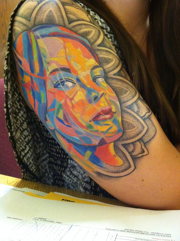 Amazing looking colored shoulder tattoo of woman portrait