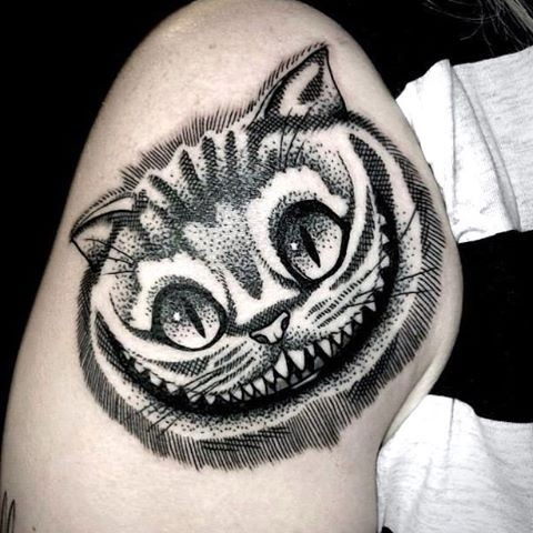 Amazing looking dot style shoulder tattoo of smiling fantasy cat head