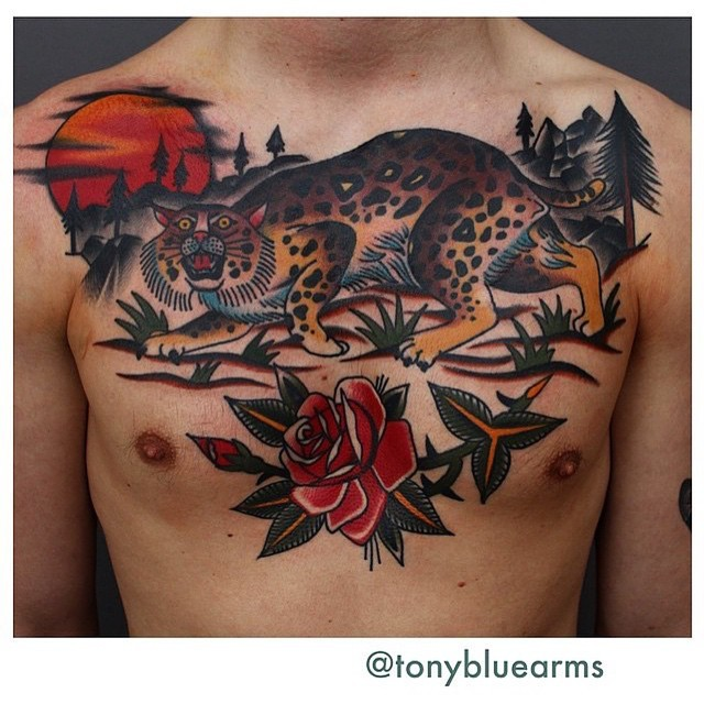 Amazing old school colored leopard in wild life tattoo on chest with flower