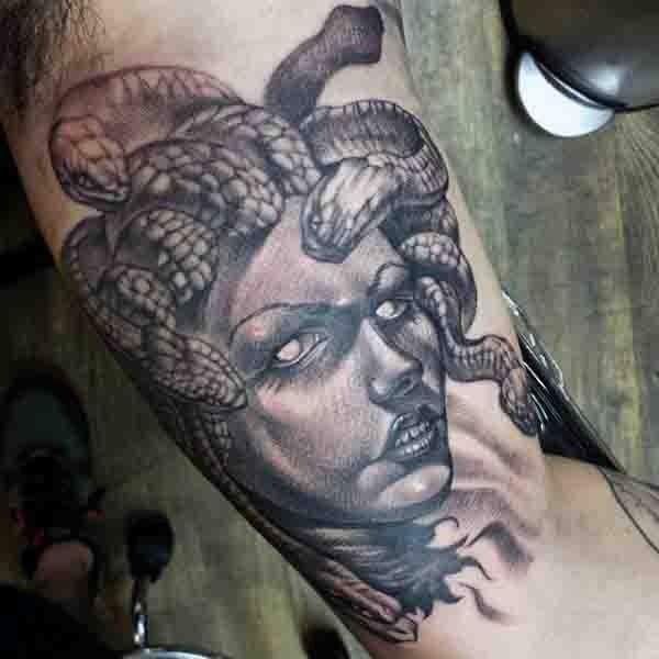 Amazing painted 3D like evil Medusa head tattoo on arm