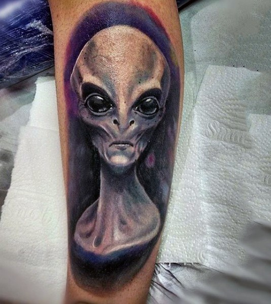 Amazing painted and colored very detailed alien portrait tattoo on arm