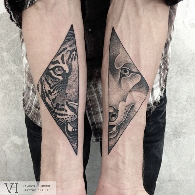 Amazing painted by Valentin Hirsch tattoo of split animal portraits on forearms