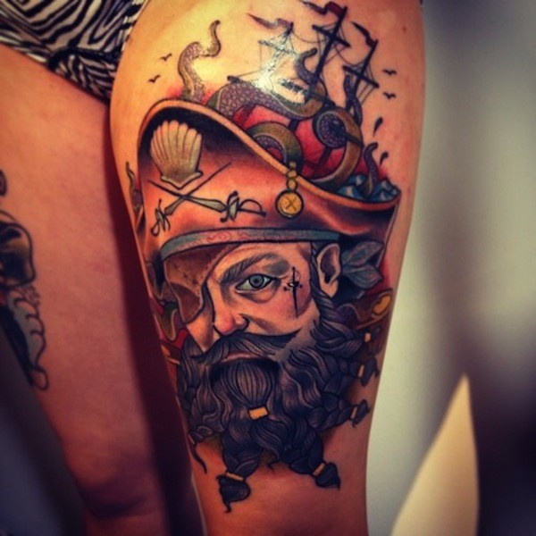 Amazing pirate face tattoo onleg for lady