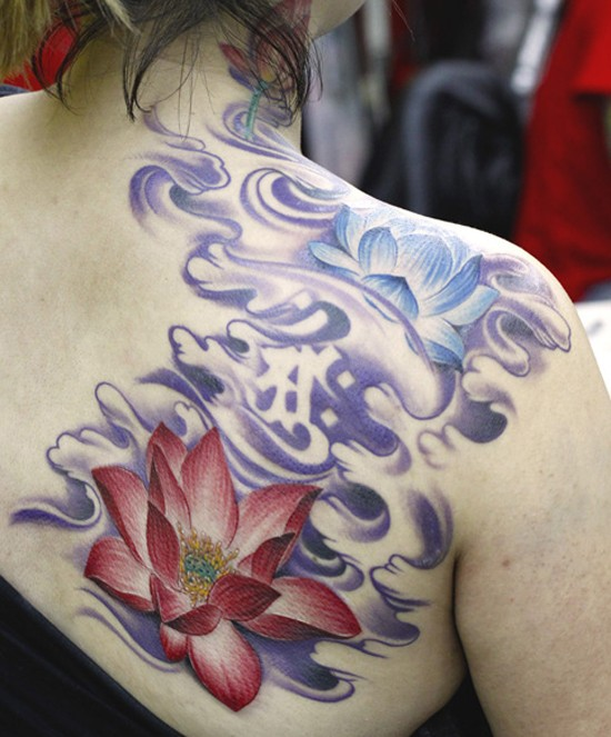 Amazing purple and blue lotuses tattoo