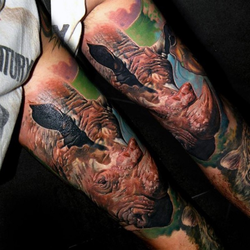 Amazing realistic colored detailed sleeve tattoo of rhino