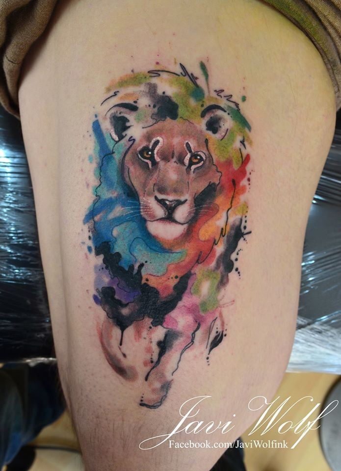 Amazing running lion tattoo on side by Javi Wolf with colored paint drips in watercolor style