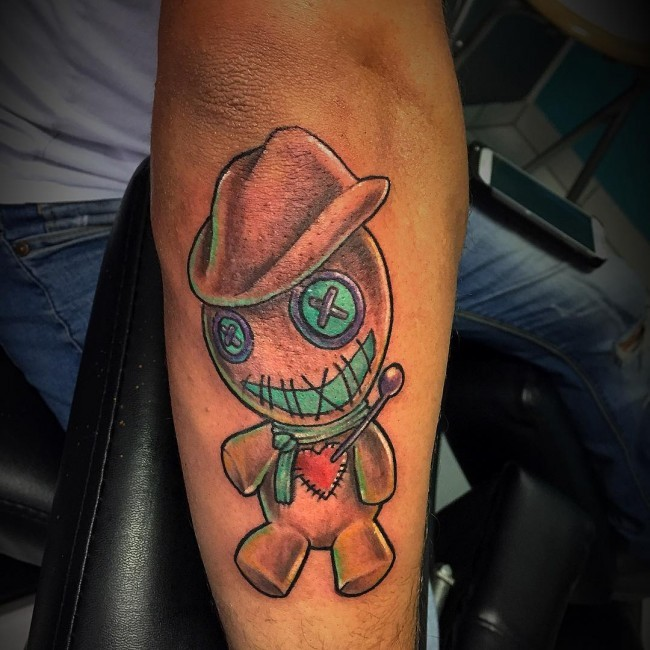 Amazing tiny colored forearm tattoo of cowboy voodoo doll