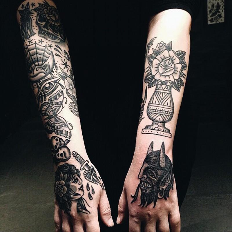 Amazing various symbols and portraits tattoo on sleeve