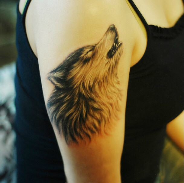 Amazing wolf face tattoo on shoulder