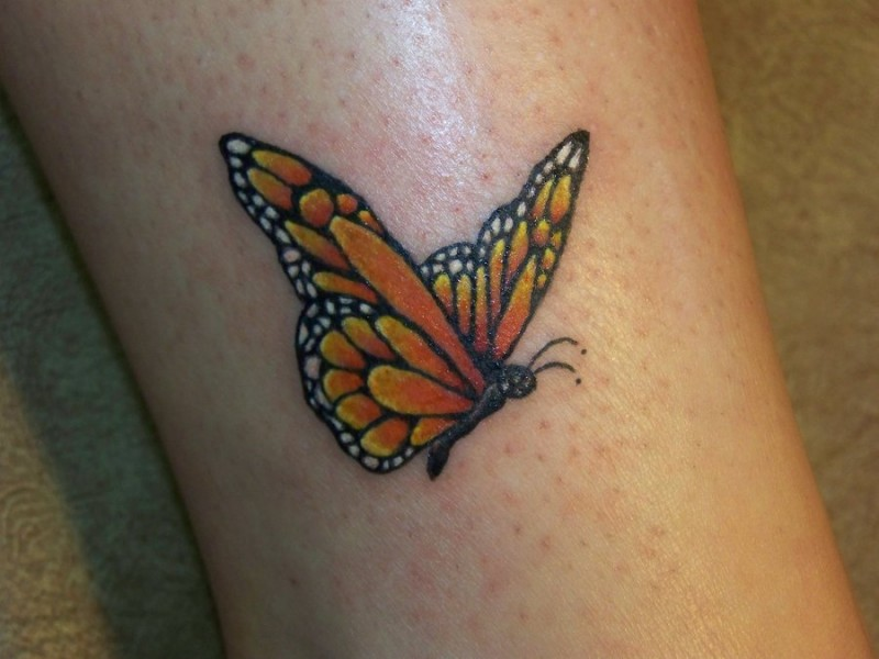 Amazing yellow small butterfly tattoo on leg for Butterfly tattoos gallery