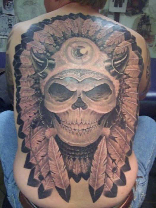 Skull in american indian feather crown large tattoo