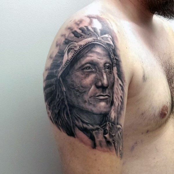 American native black and white detailed on shoulder tattoo of Indian chief