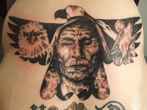 American native colored and detailed eagle tattoo on back stylized with Indian chief and wolf