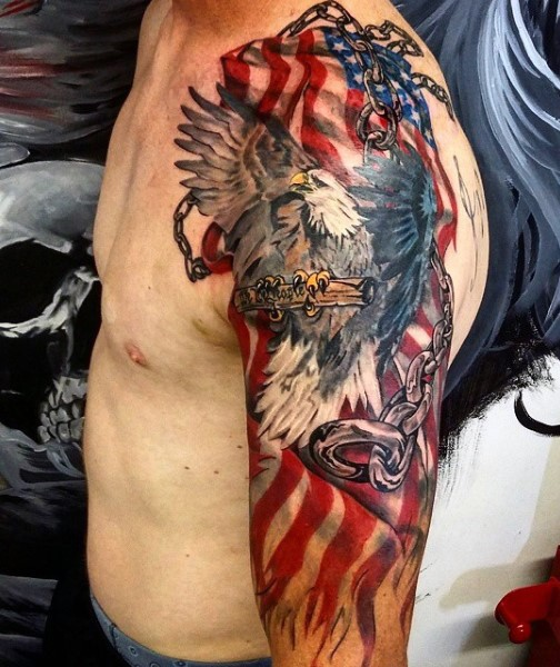 American Native Multicolored Flying Eagle With Chained Flag Arm Tattoo