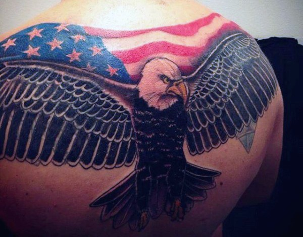 American native painted and colored eagle with national flag tattoo on upper back
