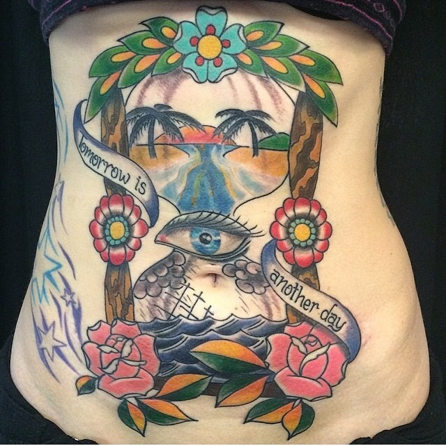 American traditional colored belly tattoo of sand clock stylized with eye, flowers and lettering