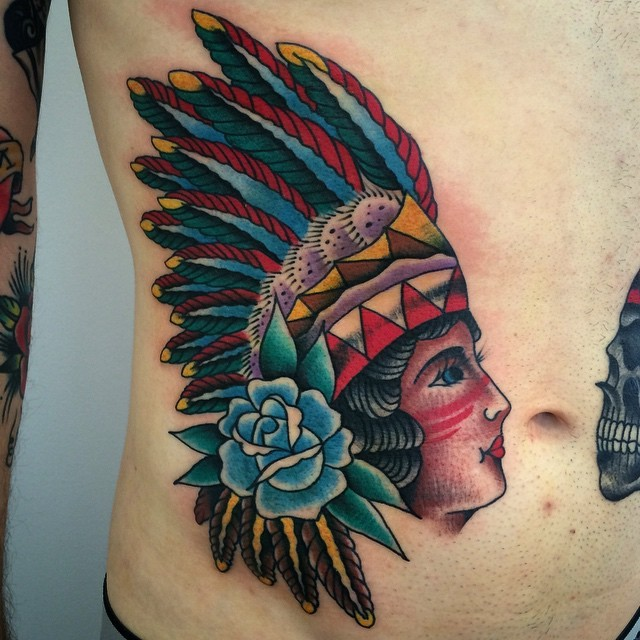 American traditional Indian chief colored belly tattoo with blue rose and skull