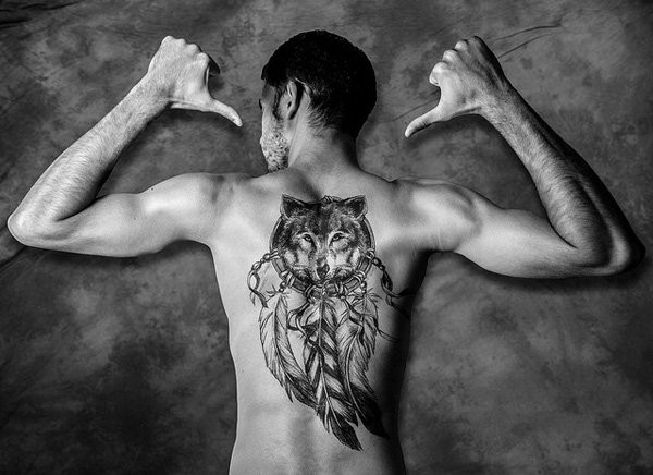 American traditional Indian dream catcher and wolf massive back tattoo