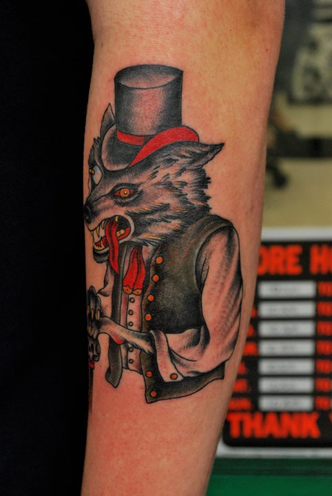American traditional style colored arm tattoo of mystical wolf