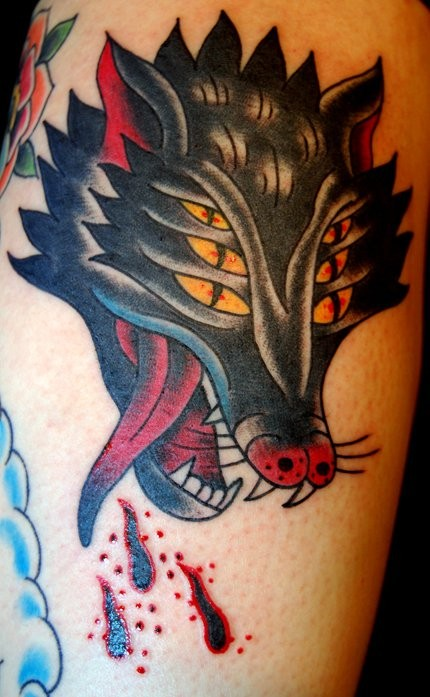 American traditional style colored shoulder tattoo of hell dog head
