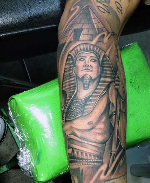 Ancient Egypt themed black ink forearm tattoo of Pharaoh and pyramid