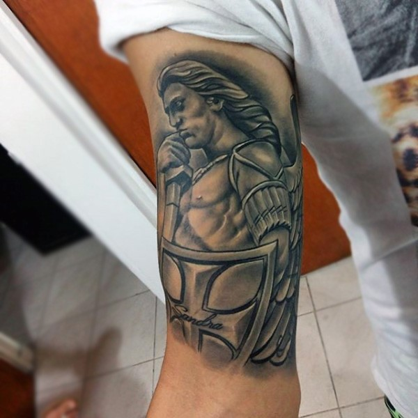 Ancient man muscular warrior angel with shield detailed tattoo on man&quots biceps