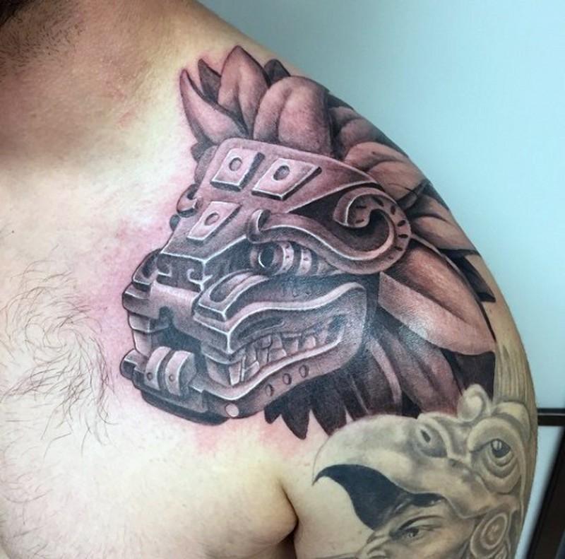 Ancient tiger statue tattoo on shoulder