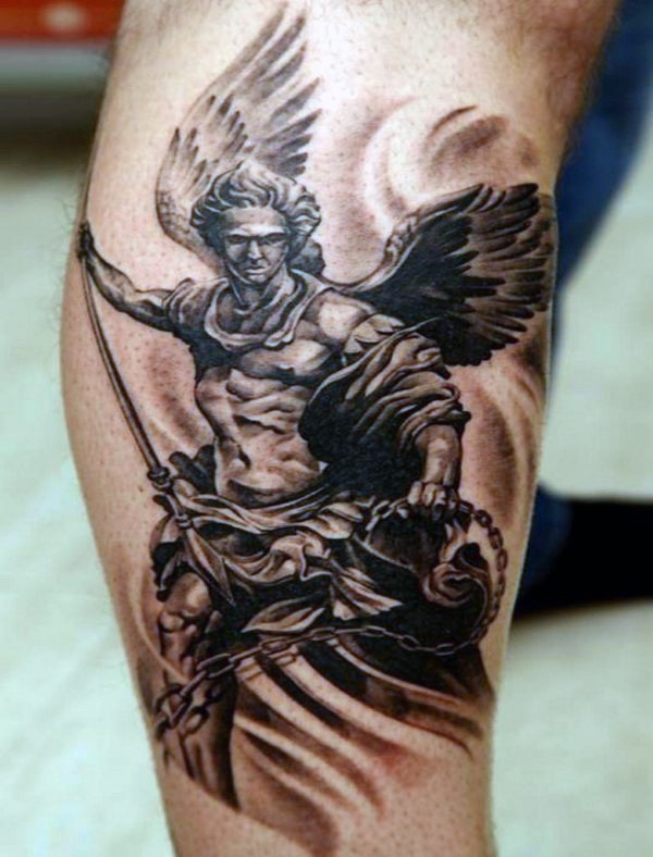 Angel man warrior with chain and spread detailed tattoo on calf