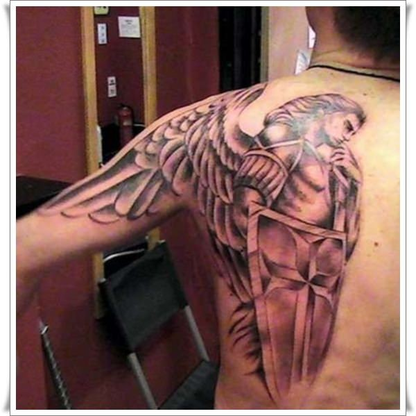 Angel warrior with a shield and sword tattoo on shoulder blade