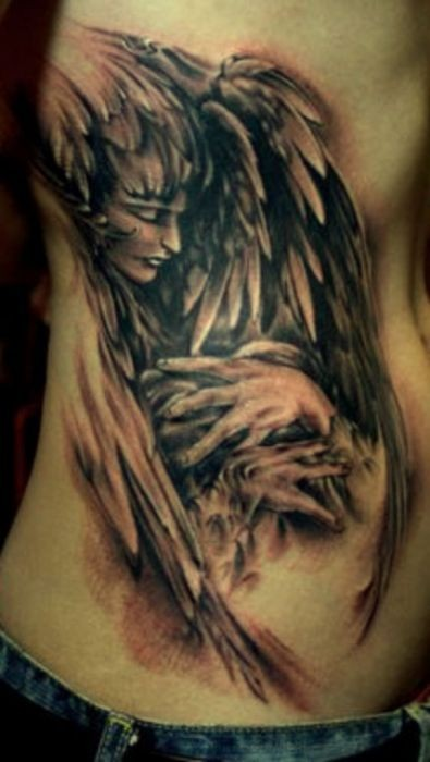 Angel with hands wings tattoo on ribs