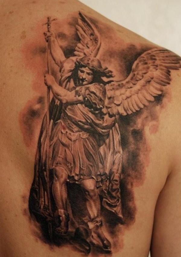 Angel with spear tattoo on shoulder blade
