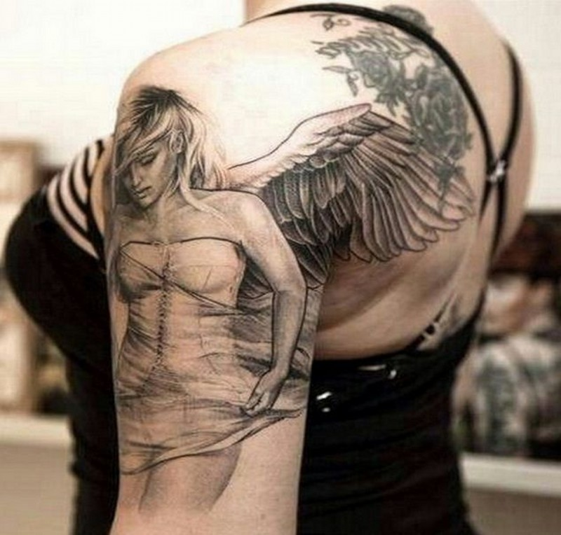 Angel woman with wings tattoo on shoulder