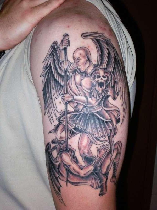Angels and demons killing shoulder tattoo