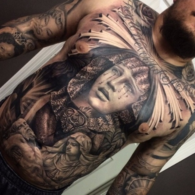Antic like 3D very detailed crying woman tattoo on chest and belly with lettering and statues