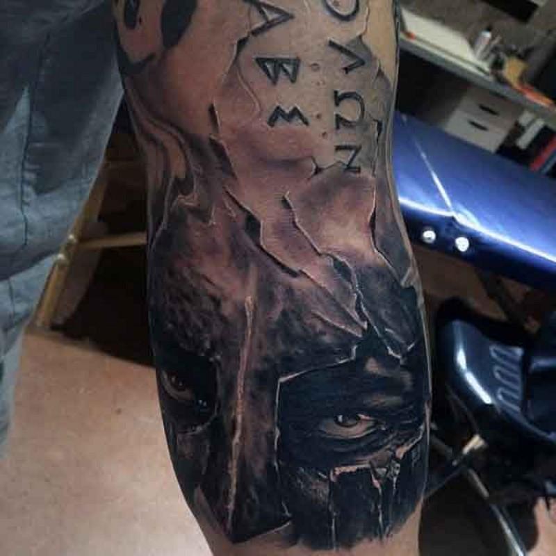 Antic Spartan warrior corrupted helmet tattoo on half sleeve with lettering