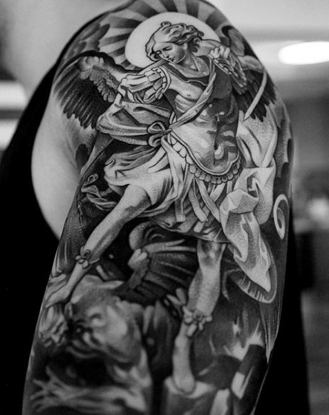 Antic style black and white Angel warrior tattoo on shoulder with demons