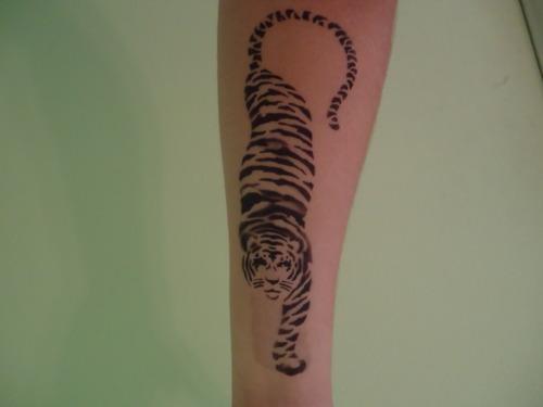 Minimalistic black tiger tattoo