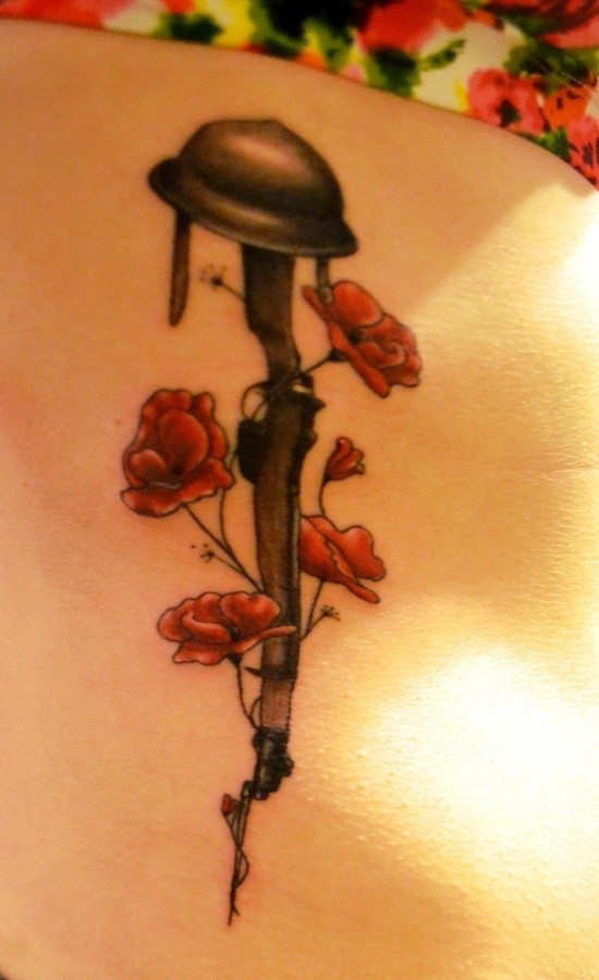 Army helmet on guns and red poppies memorial tattoo