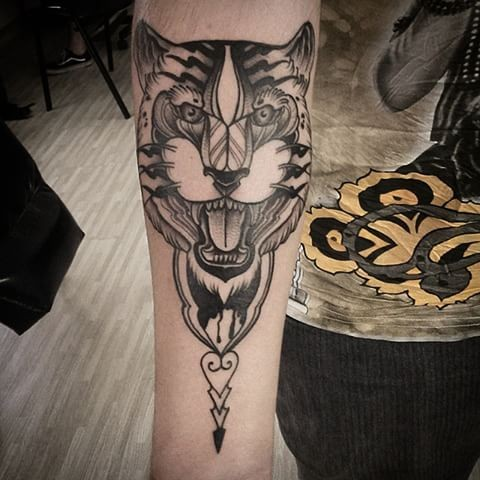 Art style black ink arm tattoo of roaring tiger